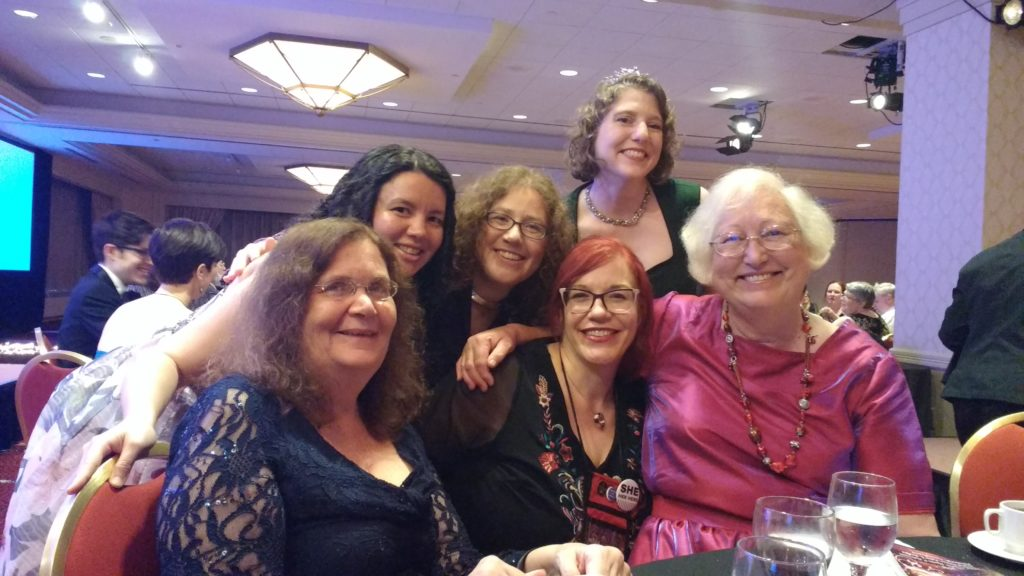 A picture at the Uncanny/Asimov's table with Sheila Williams, Connie Willis, a visiting Kelly Robson, Lynne M. Thomas, Caroline M. Yoachim, and Sarah Pinsker.